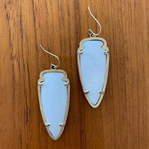 Kendra Scott arrowhead style earrings.